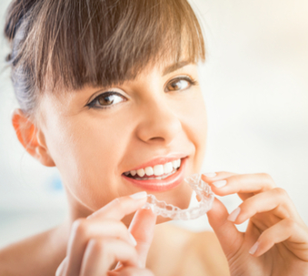 woman with straight teeth using invisalign